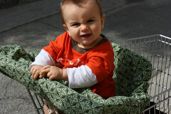 Sit baby in covered shopping cart or high chair